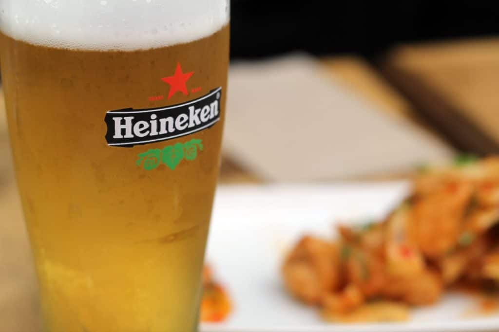 Glass of Heineken beer with food
