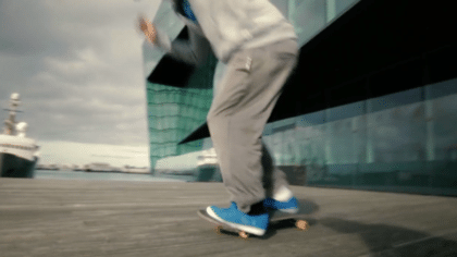 A kid skating in what is supposed to be Rhode Island, but is actually Iceland.