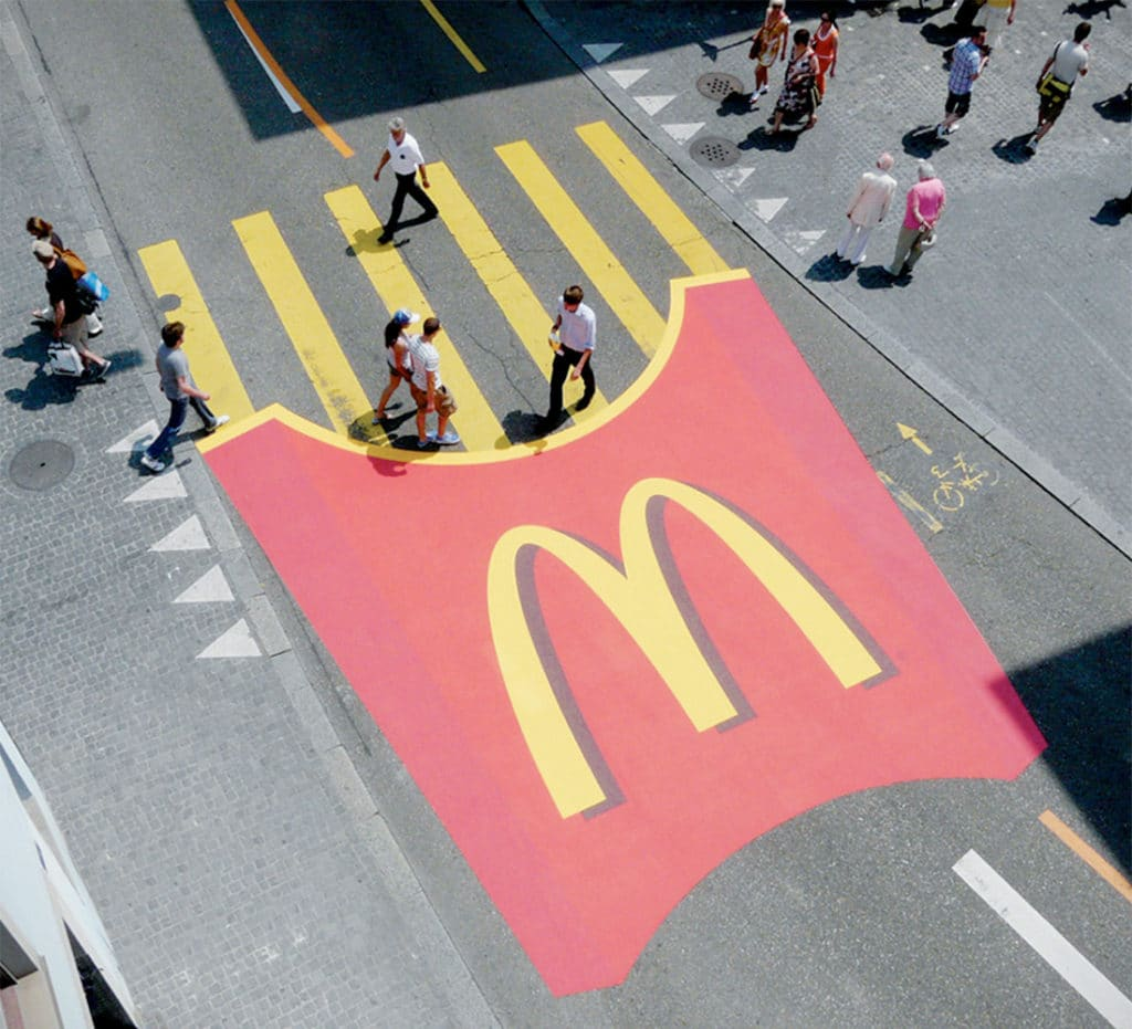 A cleverly placed ad by McDonalds, with french fries in place of a crosswalk.