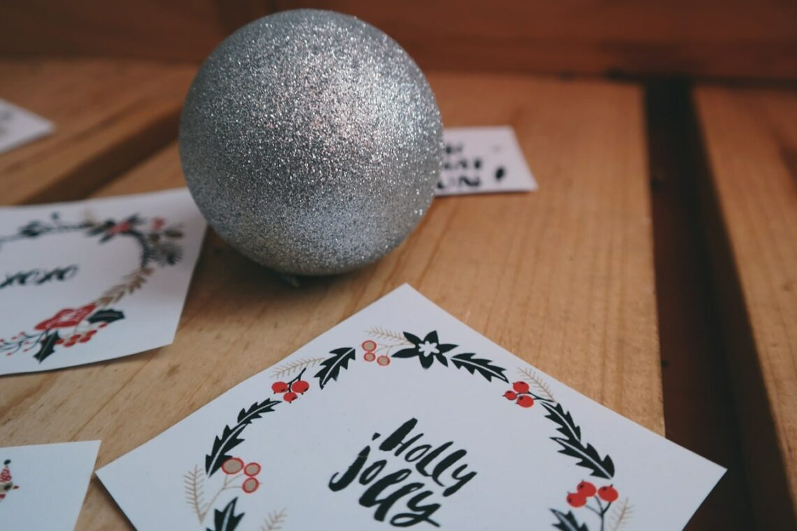 Holiday decorations including a silver bauble