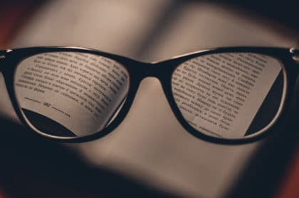 Glasses focusing on writing