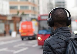 Man listening to podcast with headphones