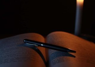 Writing in candlelight