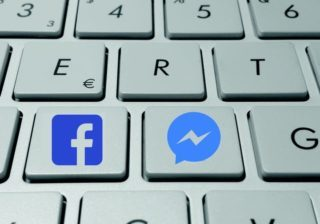 Computer keyboard with keys for Facebook and Twitter