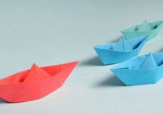 image of paper boats following a larger paper boat representing thought leadership