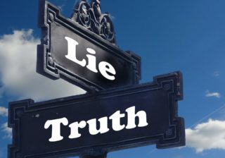 """Signposts labelled """"lie"""" and """"truth"""", indicating the different paths that can be taken"""