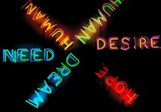 image of neon sign reading need and desire, representing human motivation