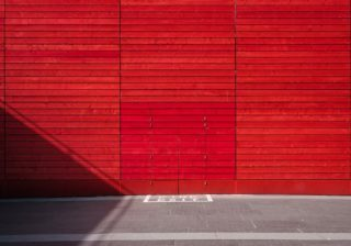 A bland red textured wall