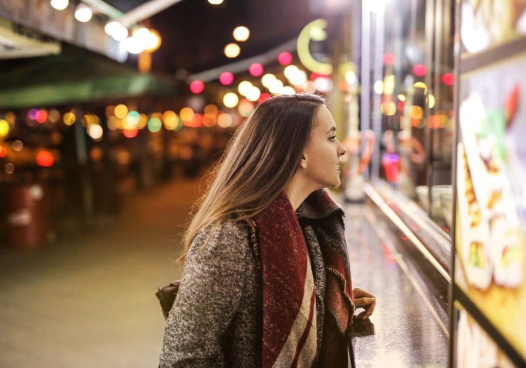 https://www.pexels.com/photo/woman-in-brown-coat-standing-on-sidewalk-during-night-time-3775136/