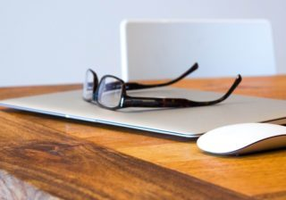 Glasses on a closed laptop